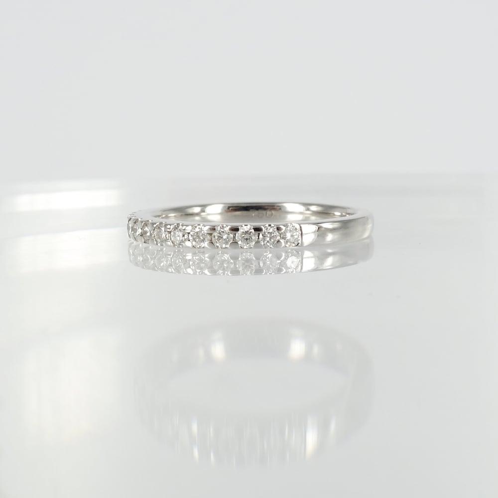 Image of 18ct white gold diamond set wedding band.