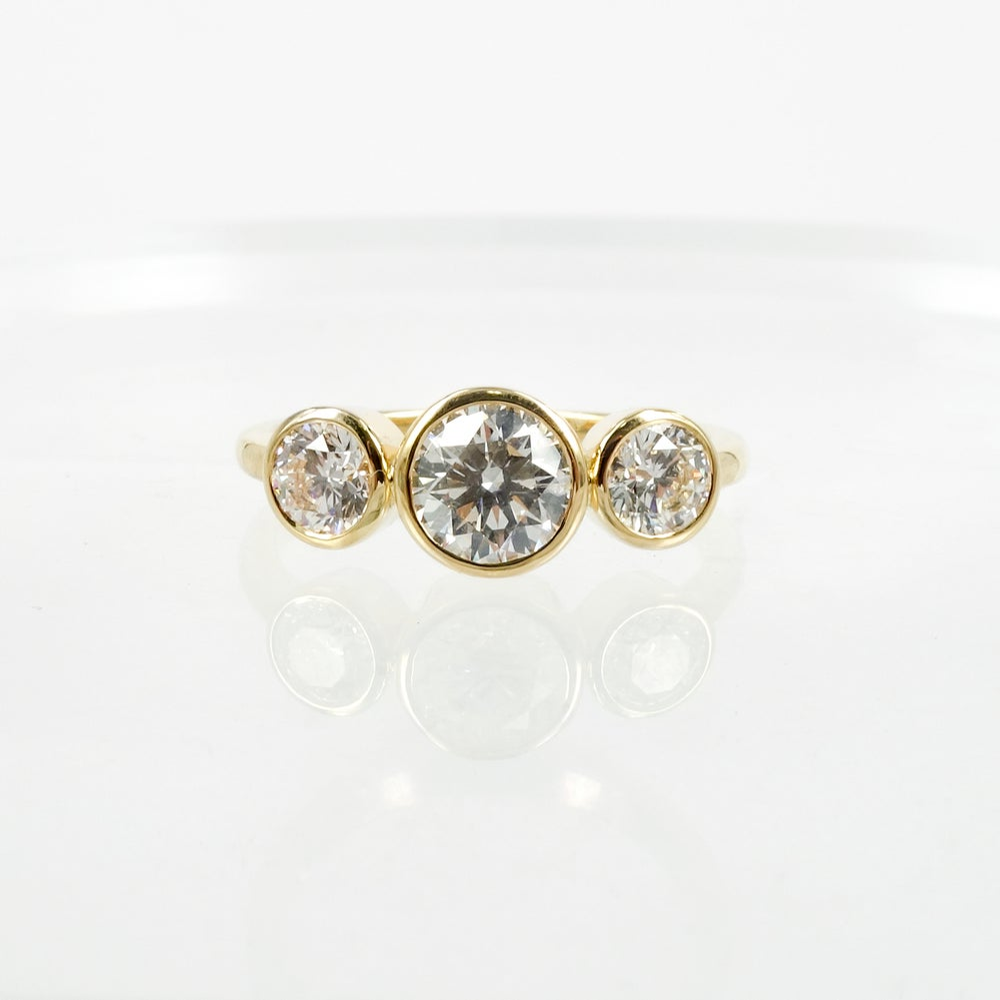 Image of 18ct yellow gold bezel set trilogy ring. PJ5790