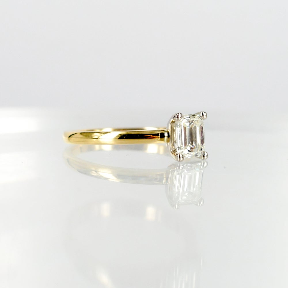 Image of 18ct yellow gold 1ct Asscher cut diamond solitaire ring.