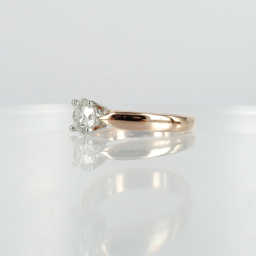 Image of 18ct rose gold solitaire diamond ring.