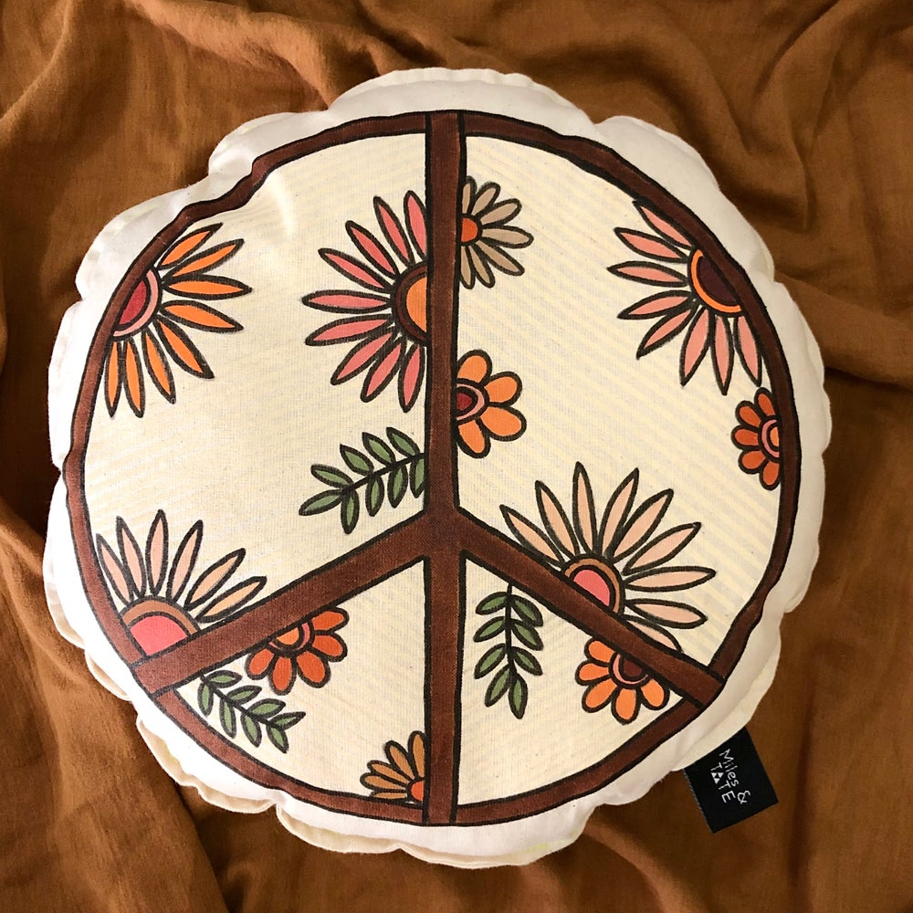 Image of Vintage floral peace sign cushion