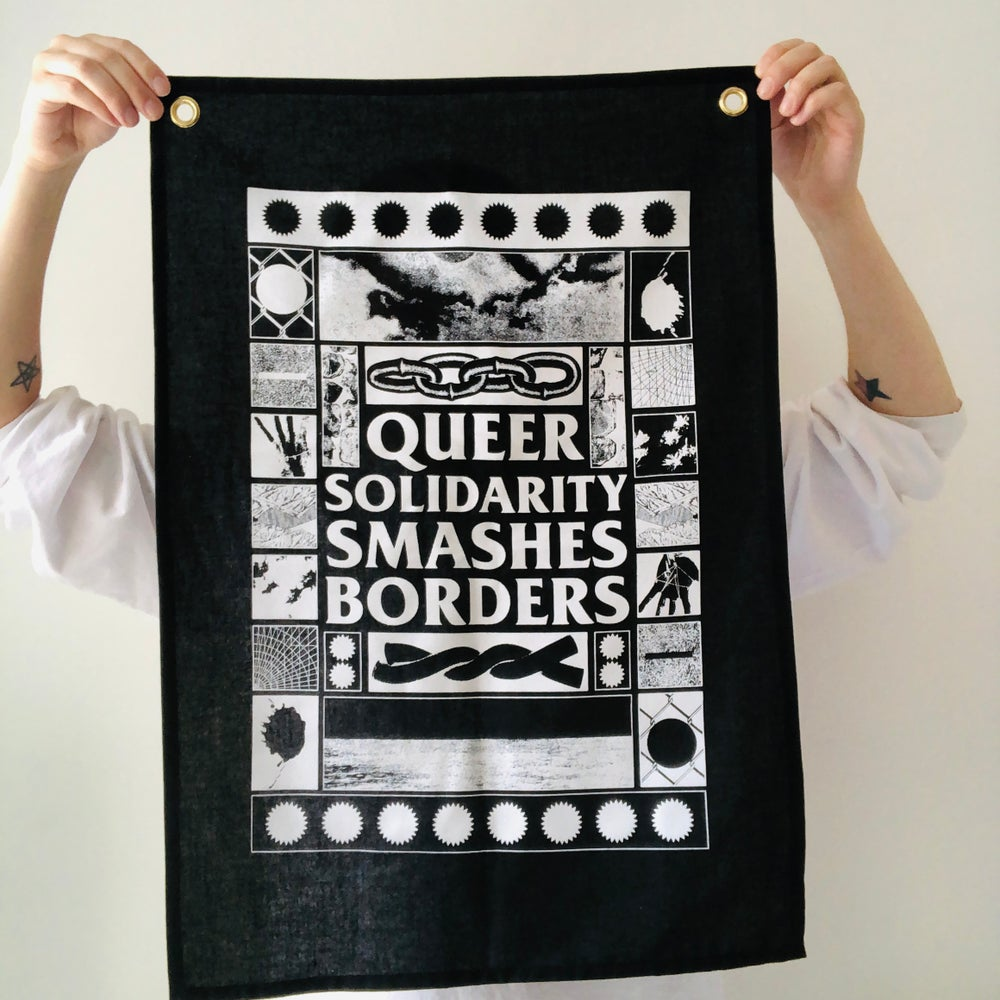 Image of Queer Solidarity Smashes Borders fabric wall hanging