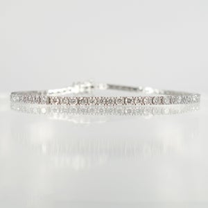 Image of 18ct white gold tennis bracelet set with .05pt D-E SI lab grown diamonds. TB1