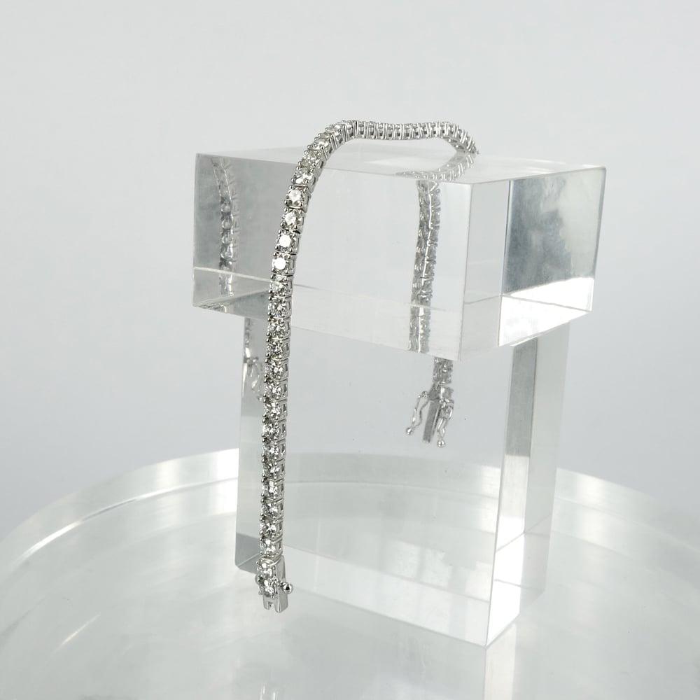 Image of 18ct white gold tennis bracelet set with .10pt D-E SI lab grown diamonds. TB2
