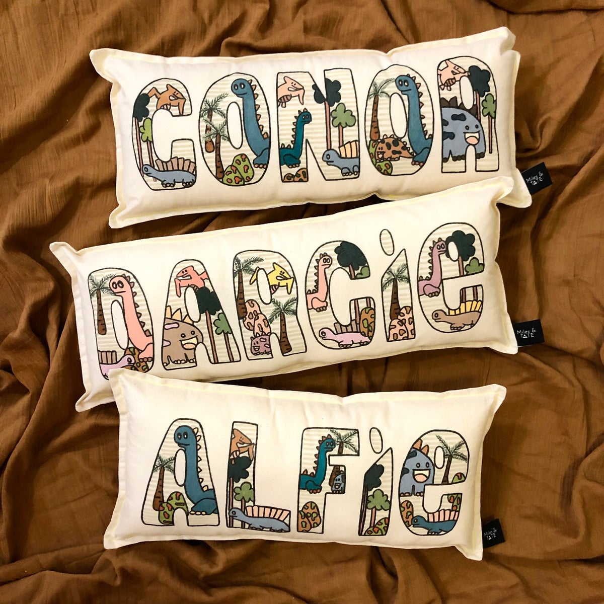 Image of Dinosaur personalised name cushion