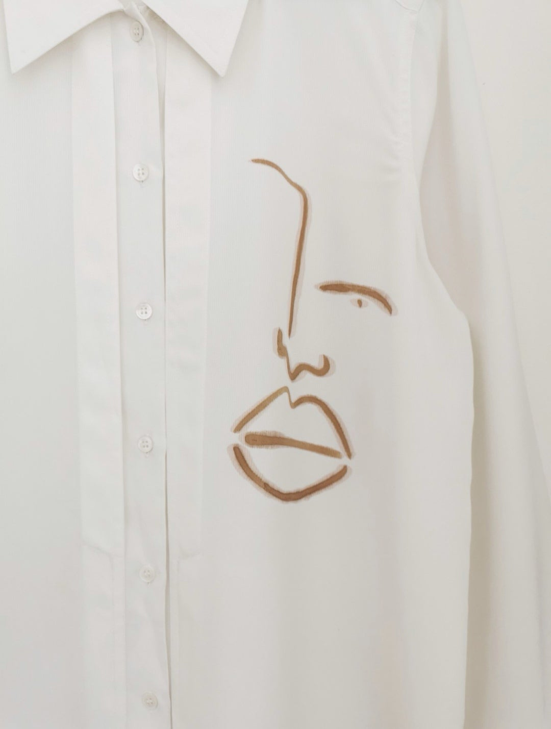Image of one face shirt