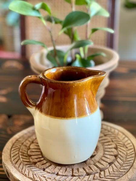Image of A vintage ceramic pitcher