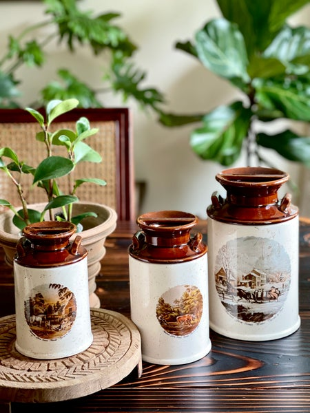 Image of A set of 3 vintage milk can kitchen canisters