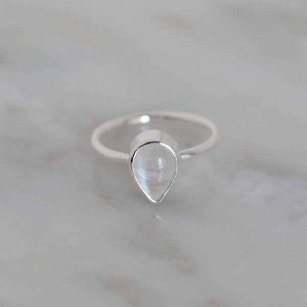 Image of Rainbow Moonstone pear shape cabochon cut classic silver ring