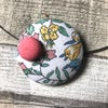 Large floral covered button necklace