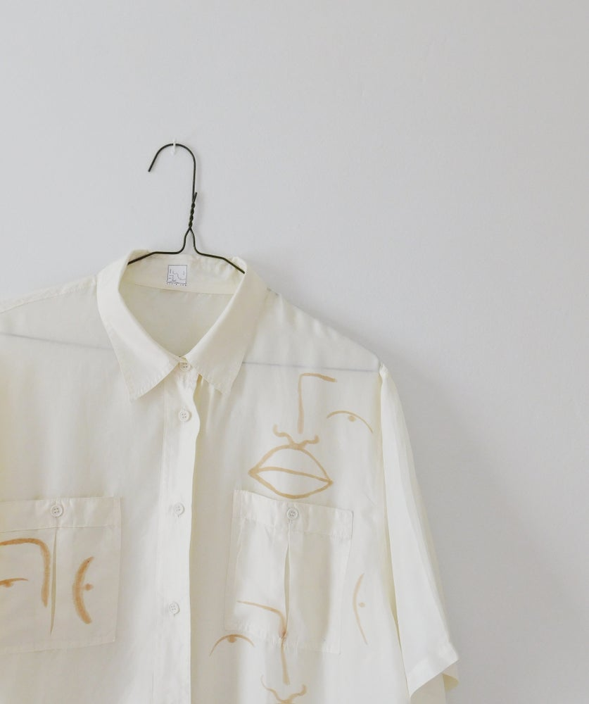 Image of pearly blouse