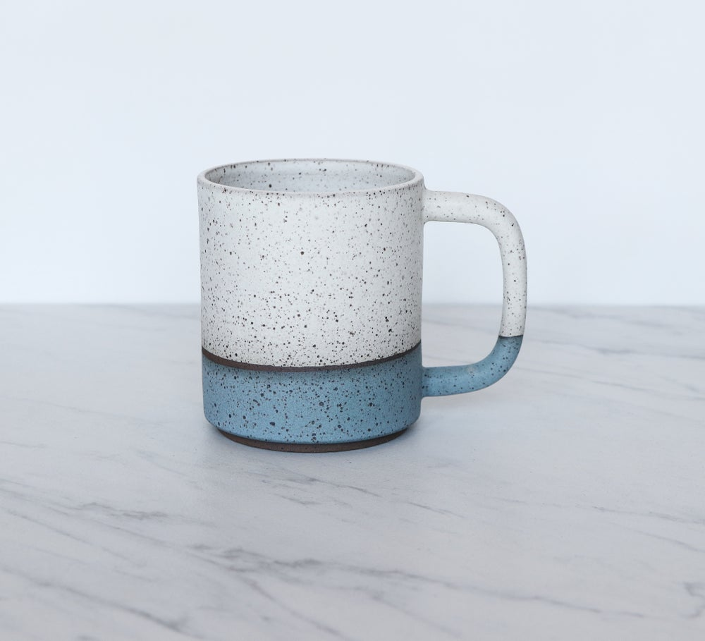 Image of 12 oz coffee mug, speckled clay, glazed in cream + turquoise