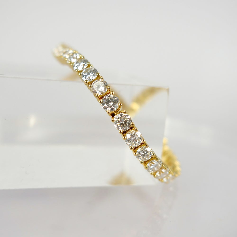 Image of 18ct yellow gold tennis bracelet set with .20pt D-E SI lab grown diamonds. TB4