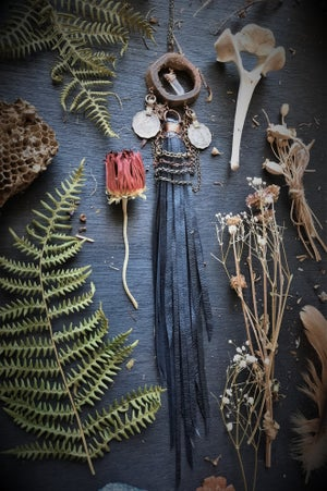 Image of Cow Vertebrae with Quartz Crystal, Turkish Coin, Chains, and Leather Fringe Necklace