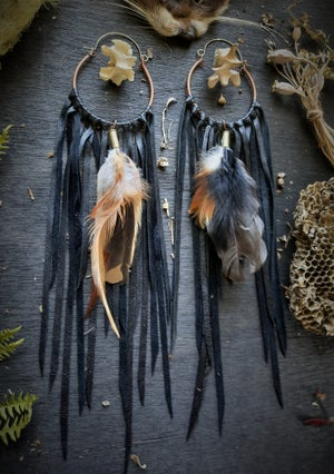 Image of Coyote Vertebrae with Leather Fringe and Feathers