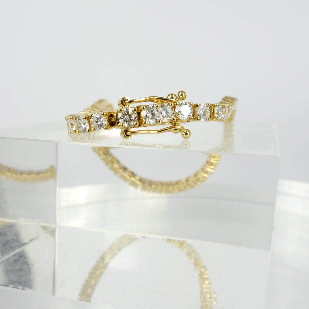 Image of 18ct yellow gold tennis bracelet set with .10pt D-E SI lab grown diamonds. TB5