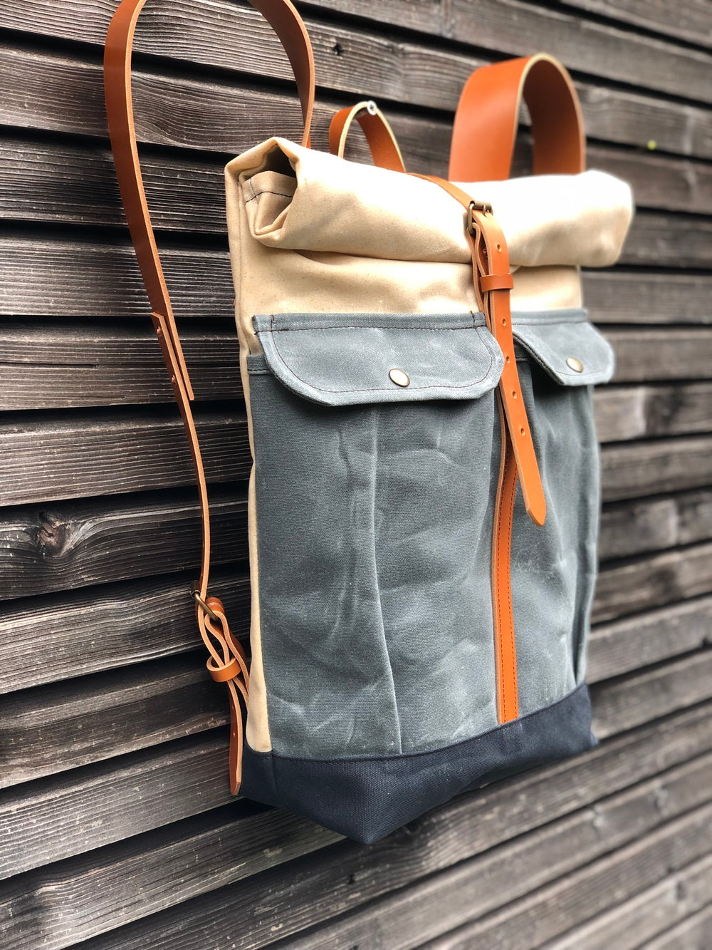 Image of Waxed canvas rucksack with roll to close top and vegetable tanned leather shoulder straps