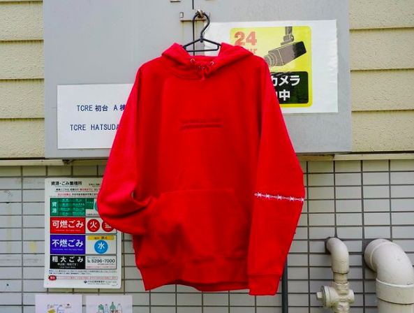 THE WHOLE DAMN SYSTEM IS WRONG HOODIE (RED)