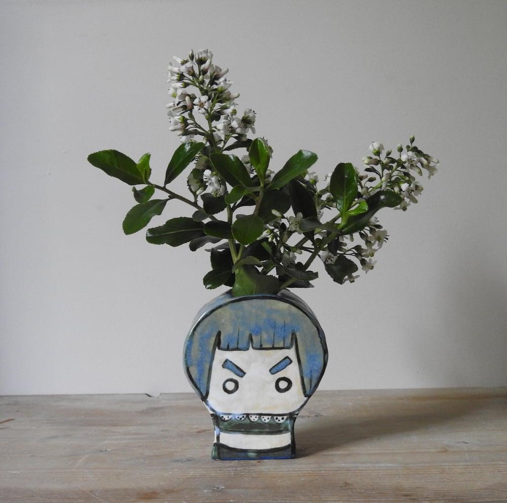 Image of pretty collar grumpy girl - vase