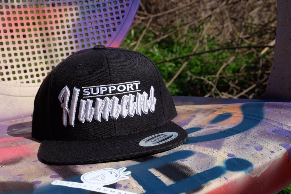 Image of Support Humans - Black Snap Back Hat