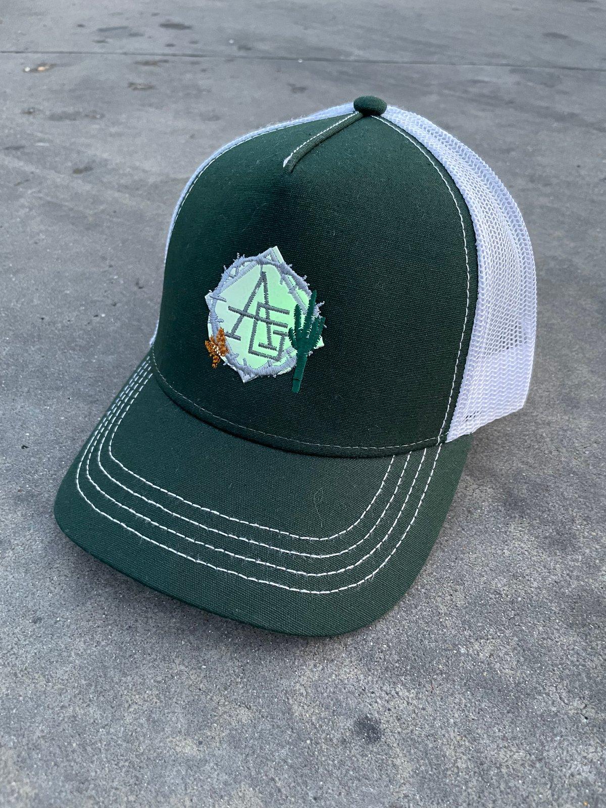 Image of Glow in the dark green bottle cactus trucker hat 🌵
