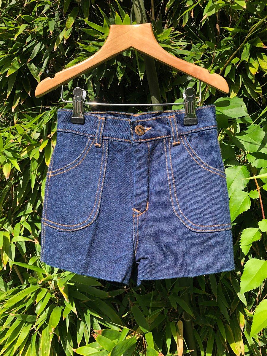 Image of Dark indigo denim shorts with orange stitching. Age 4-5yrs.