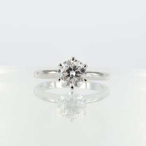 Image of Elegant 18ct white gold 1.01ct GSI2 XXX solitaire diamond engagement ring. Pj5827