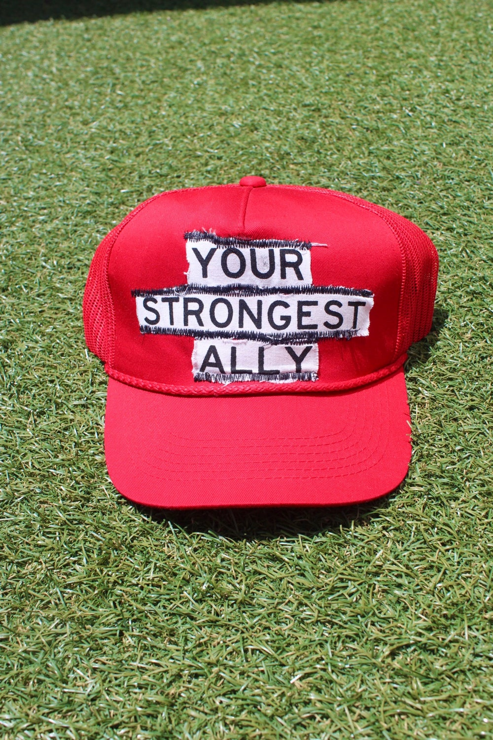 your strongest ally trucker hat in red