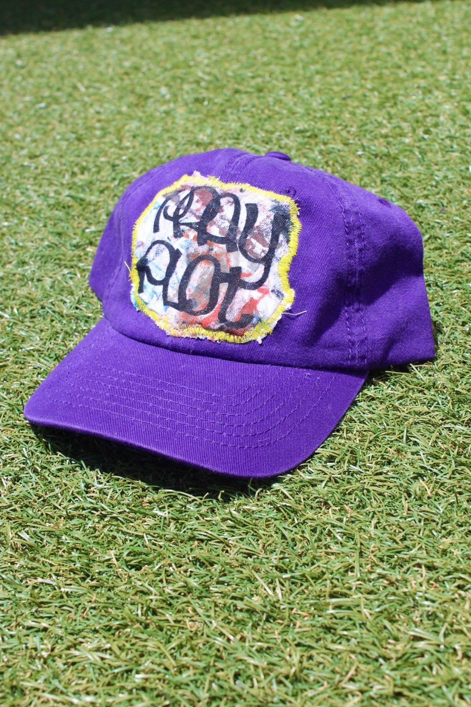 on plot cap in purple