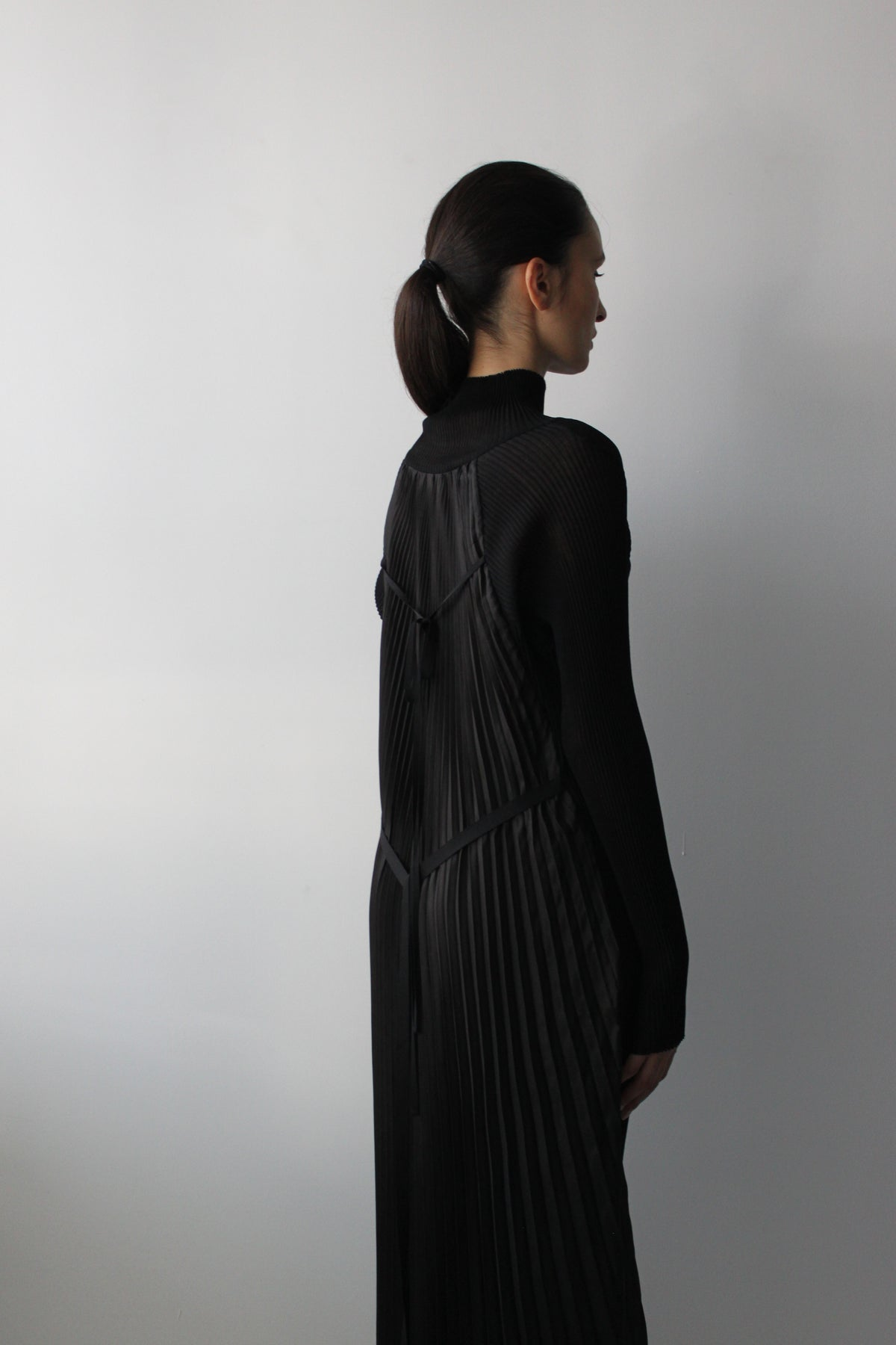 Turtle neck textured jersey dress with back pleats