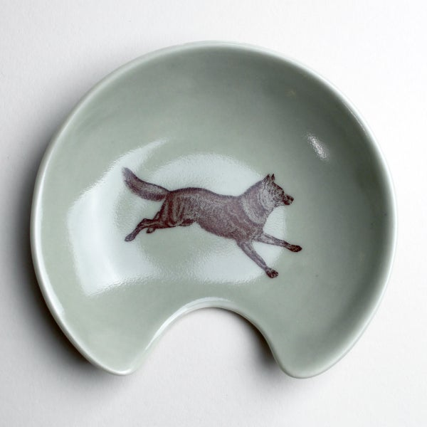 Image of spoon holder with wolf, sage