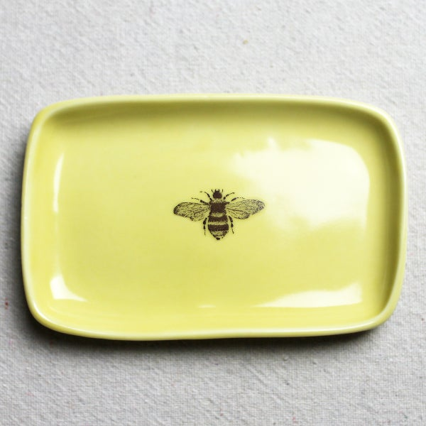 Image of small rectangular tray with bumblebee, mustard