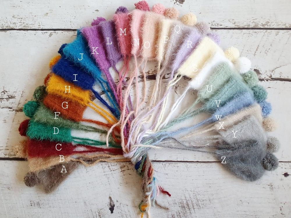 Image of Newborn pom pom bonnets. Ready to post