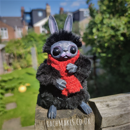 Image of Black Bunn with Rust Red Scarf