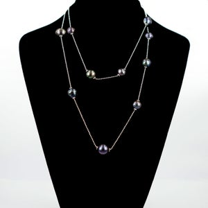 Image of Sterling silver necklace with adjustable black fresh water pearls. M3227
