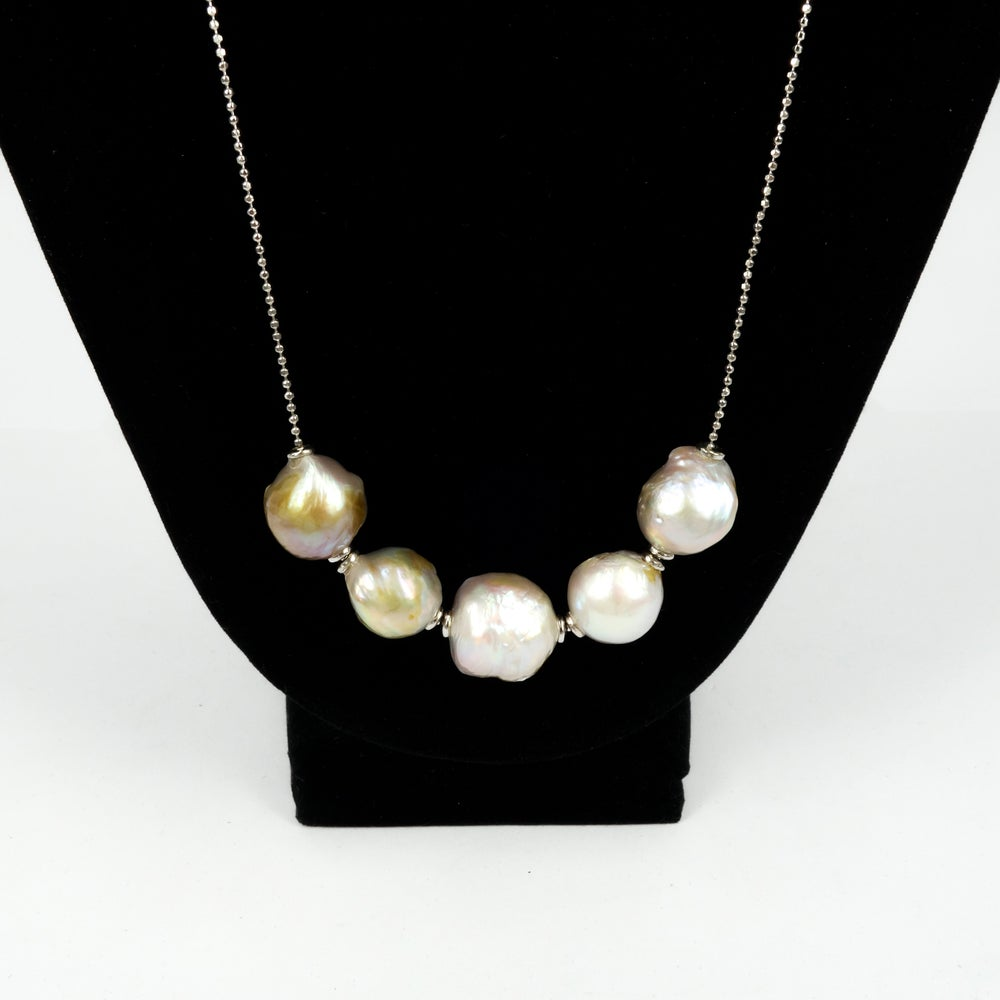Image of Sterling silver necklace with adjustable cream fresh water pearls. M3228a