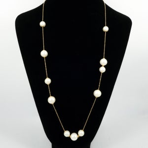 Image of Yellow gold / sterling silver necklace with adjustable cream fresh water pearls. M3229