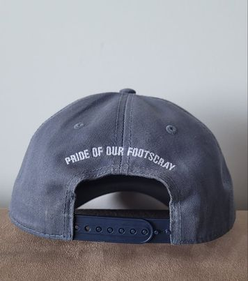 Limited Edition Pride Cap designed by Mitchell Boothby. Petrol blue with orange logo on front.