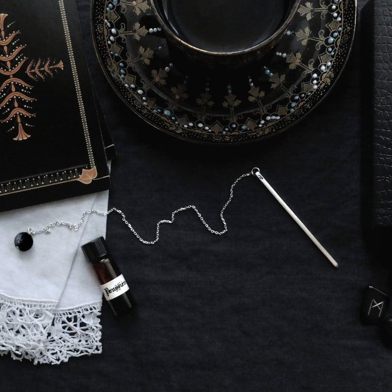 Image of FLEUR DE POUSSIÈRE. PENDULUM ↟ sterling silver & black lava/rosewood bead + patchouli rose potion