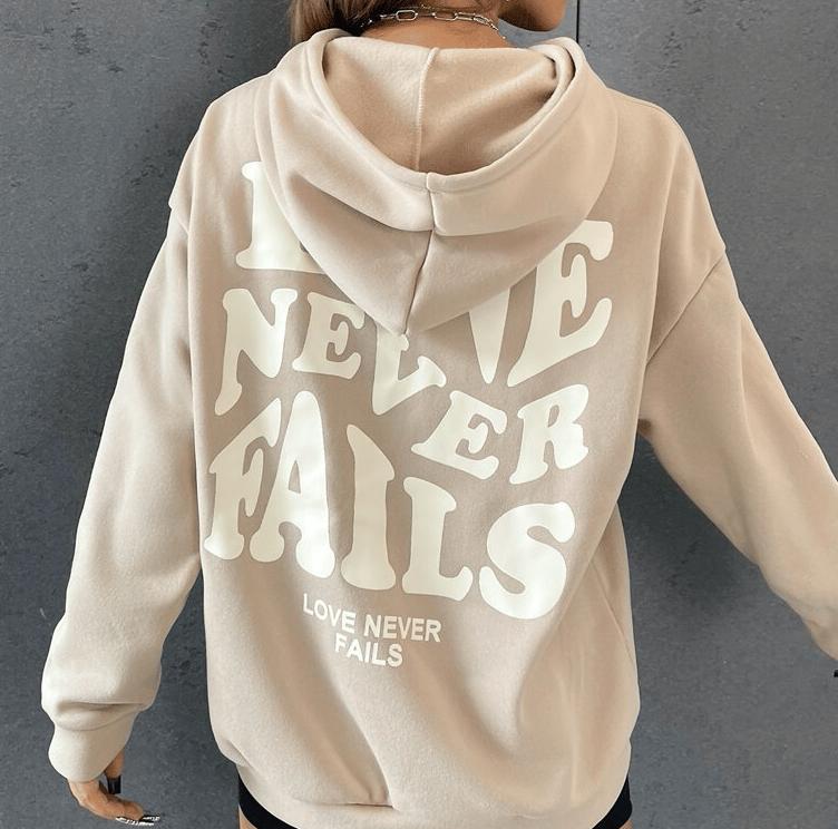 Love Never Fails Sweater