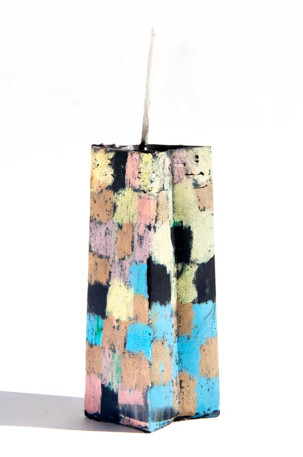 Image of Stack Star Tower in soft yellow, taupe, pink, green, orange, black and baby blue