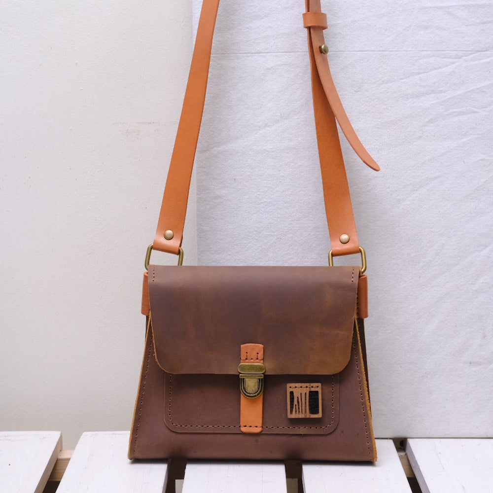 Image of Girl Scout in vintage brown and tan