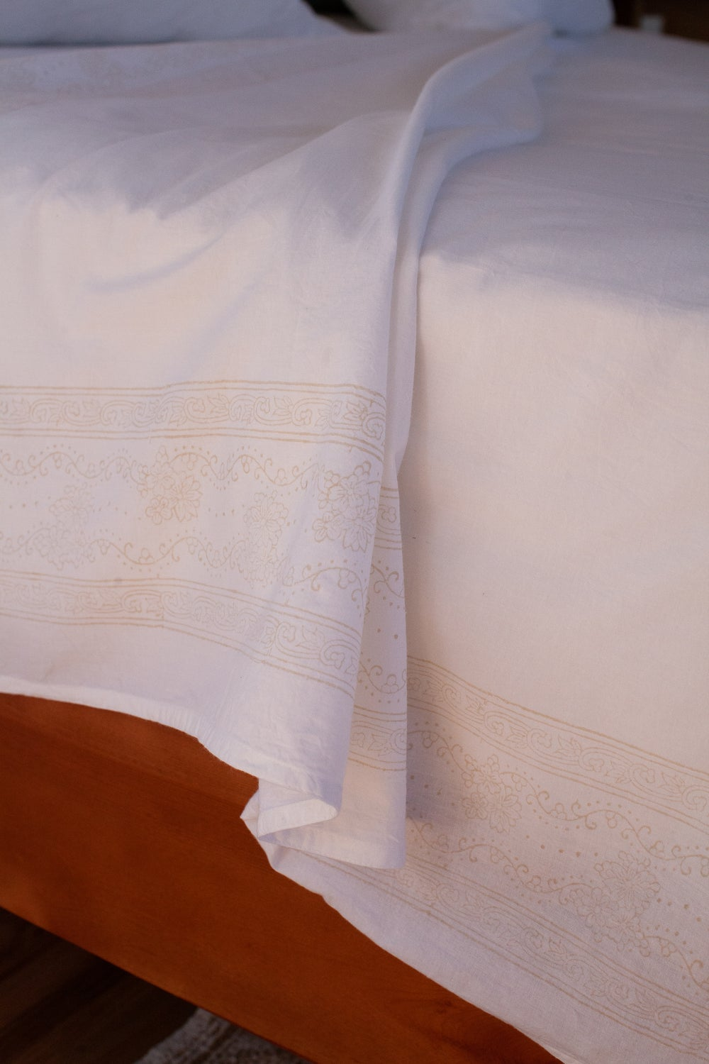 Image of White Sheet with Sand Border