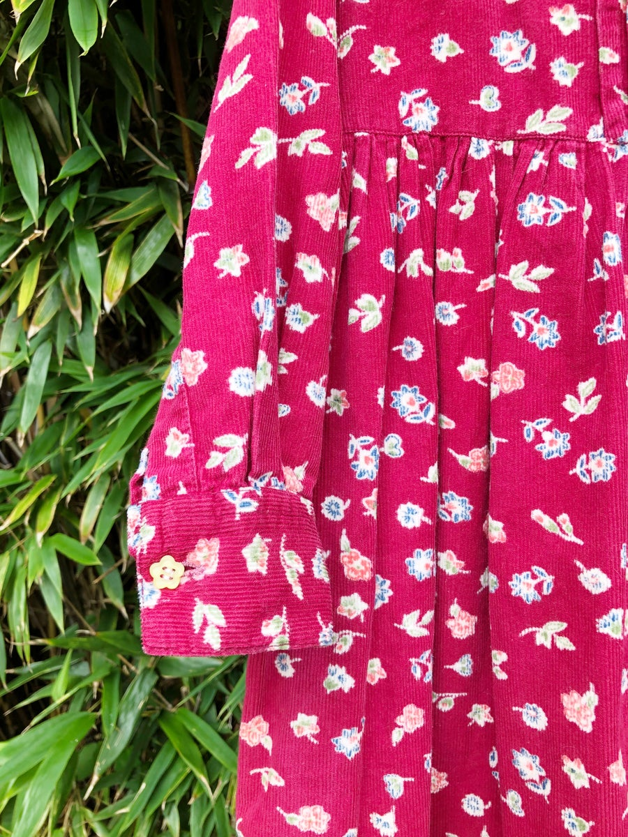 Image of Floral dress in wine coloured corduroy. Age 6-7yrs.