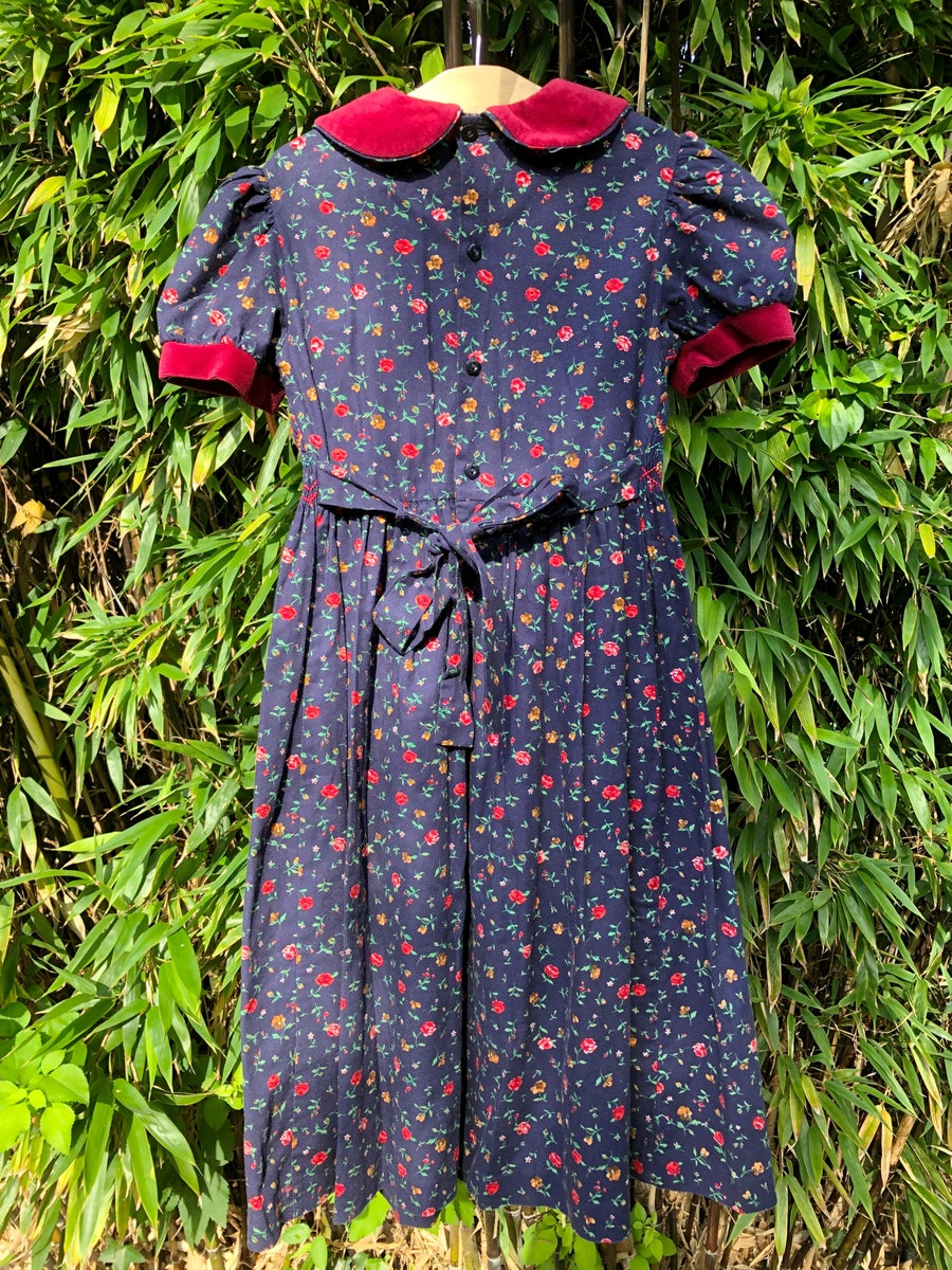 Image of Classic, traditional dress with smocking and velvet collar. Age 8-9yrs.