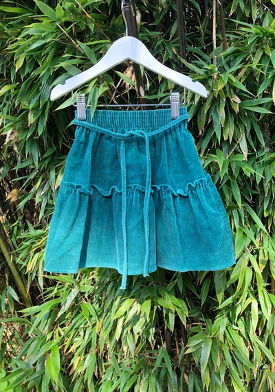 Image of Soft mid green corduroy skirt with ruffle. Age 2-3yrs.