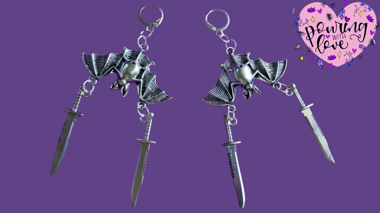 Image of sword-fighting bat earrings