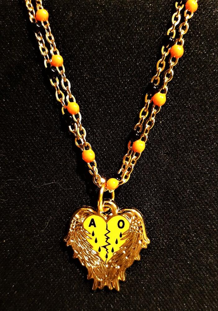 Image of Agent Orange Angel Heart Necklace