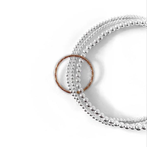 Image of Sterling Silver & Rose Gold Circle Triple Connector Bracelet
