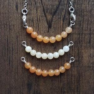 Image of gemstone ss bars - yellow and orange